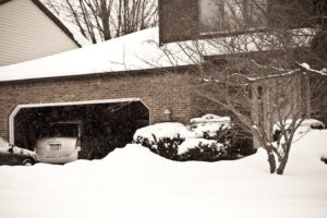 Photo of a home during winter to discuss winter home fixes.