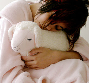 Photo of a girl hugging a stuffed animal for an article about the flu.