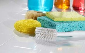 Photo of cleaning supplies on a counter for an article discussing spring cleaning.