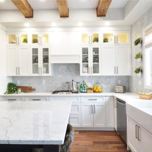 Light and bright kitchen with carrara marble countertops.