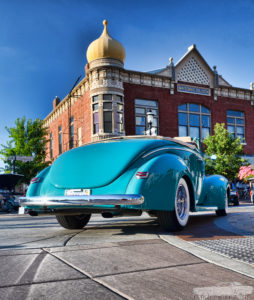 Photo of a classic car driving through downtown Plainfield.