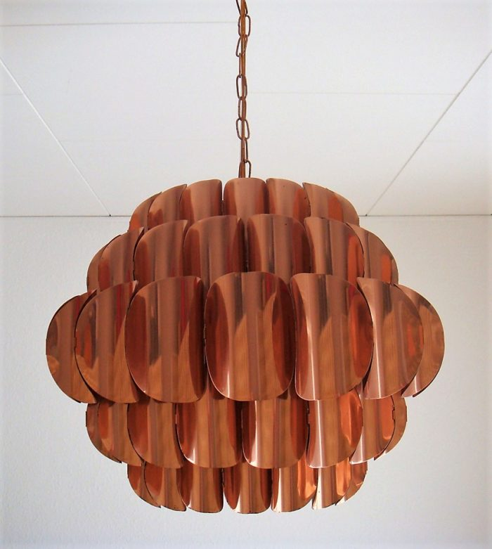 Copper light fixture for an article about spring home decor trends.