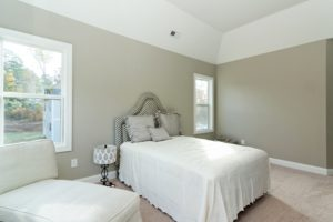 Photo of a gray bedroom for an article about farmhouse gray design.