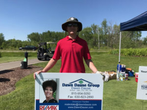 Photo of a large Dawn Dause Group business card from the Whitney Miller Golf Classic.