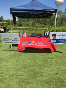 Photo of the Dawn Dause Group tent at the Whitney Miller Golf Classic.