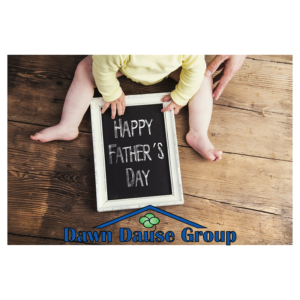 Photo of a baby holding a Happy Father's Day sign along with the Dawn Dause Group logo.