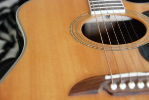 Photo of a guitar for an article about upcoming Shorewood events including an outdoor concert.