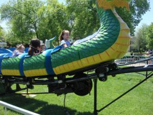 What's happening in Plainfield? Photo of kids on a ride at the Plainfield Fest which is coming up in Plainfield.