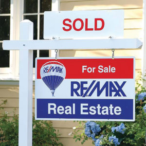 Photo of a Re/Max sign up close for an article about a recent Dawn Dause Group review.