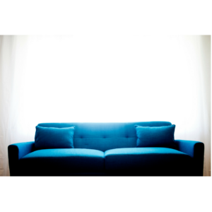 Photo of a jewel toned sofa for an article about 2018 design trends.