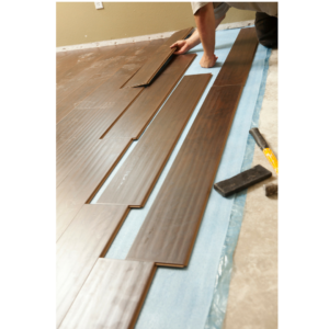 Photo of wide plank wood floors for an article about 2018 design trends.