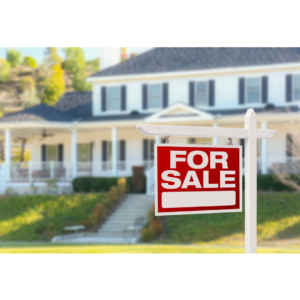Photo of a home with a for sale sign for an article about pricing a home right.