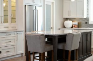 A modern kitchen with two tone cabinets, a new cabinet trend