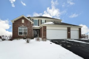 Photo of a home in the winter for an article about winter real estate.