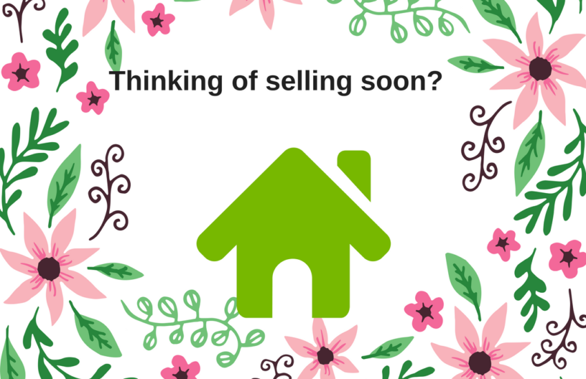 Flowers And A House To Illustrate The Spring Real Estate Market.
